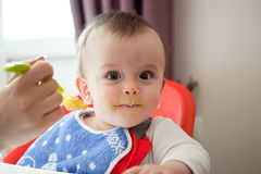 Curious smeared with food baby, eating Stock Photos
