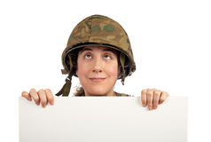 Curious soldier girl looking up Stock Images
