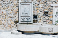 Curious stone fountain with rural scenes. North of Spain. Royalty Free Stock Photos