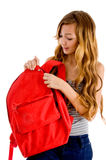 Curious student unziping bag Stock Photography