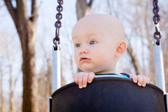 Curious Swinging  Baby Royalty Free Stock Images