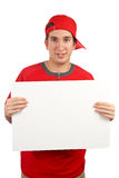 Curious teen. With a red cap behind white placard Stock Image