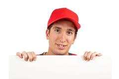 Curious teen behind white plac Stock Photos