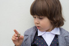 Curious Toddler boy Snail Stock Image