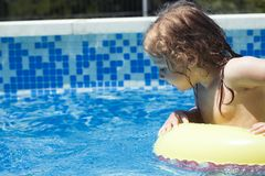 Curious toddler child safety in a swimming pool Stock Images