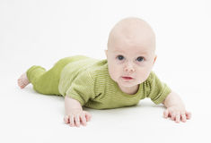 Curious toddler in green clothing Royalty Free Stock Photo
