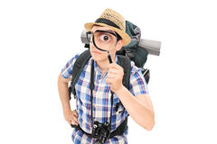 Curious tourist looking through a magnifying glass Stock Photo
