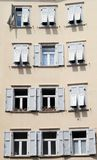 Curious windows. Old building in the heart of Rovereto royalty free stock images