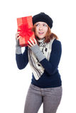 Curious winter woman with present Royalty Free Stock Photos