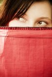 Curious woman behind veil Stock Photos