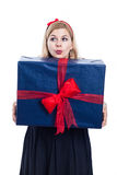 Curious woman with big present Royalty Free Stock Photography