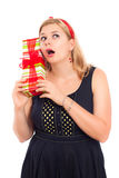 Curious woman with gift Stock Photography