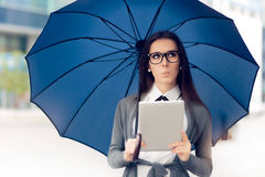 Curious Woman with Glasses, Tablet and Umbrella Out in the City Royalty Free Stock Photography