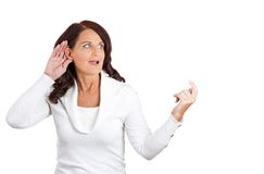 Curious woman hand to ear gesture eavesdropping Stock Photography