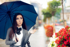 Curious Woman Holding  Umbrella Checking for Rain Stock Images