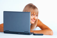 Curious woman with laptop Royalty Free Stock Images
