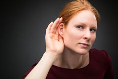 Curious Woman Listens to Rumors Royalty Free Stock Images