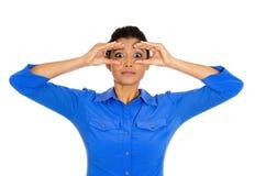 Curious woman peeking Stock Image