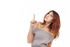 Curious woman pointing, choosing upward Stock Images