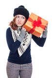 Curious woman with present Royalty Free Stock Photography