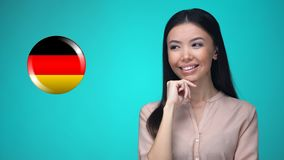 Curious woman pushing German flag button, ready to learn foreign language. Stock footage stock video
