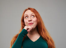 Curious woman thinking while looking upwards stock photos