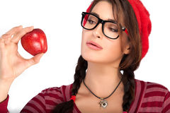 Curious Young Female Holding Small Red Apple Isolated on White Stock Photos