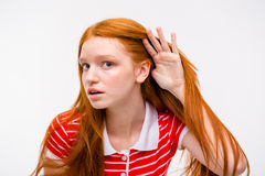 Curious young female trying to listen rumors Royalty Free Stock Photos