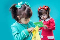 Curious young ladies observing posters with words royalty free stock photography