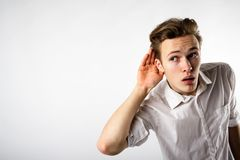 Curious young man in white. Is eager to know all the gossip stock photos
