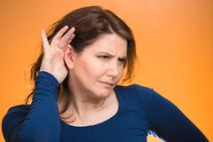Curious young nosy, funny looking woman Stock Images