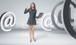 Curious young woman among e-mails Stock Photos