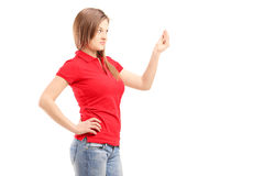 Curious young woman gesturing with hand. Isolated on white background Stock Photography