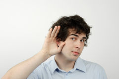 Curiousity. An image of a young man listening to something Royalty Free Stock Images