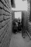 Curiousity. Curious children in Tanzania peeking inside to see what's going on Royalty Free Stock Photos