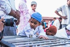 Curiousity at Jama Masjid, Delhi. A little boy have curiosity to see his reflection at front of lens during celebration of Ramadan at Jama Masjid, Delhi Stock Photos