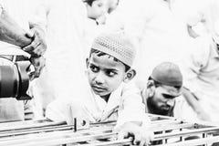 Curiousity at Jama Masjid, Delhi. A little boy have curiosity to see his reflection at front of lens during celebration of Ramadan at Jama Masjid, Delhi Royalty Free Stock Photo