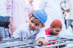 Curiousity at Jama Masjid, Delhi. A little boy have curiosity to see his reflection at front of lens during celebration of Ramadan at Jama Masjid, Delhi Royalty Free Stock Images