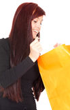 Curiously girl looking to shopping bag Royalty Free Stock Photo