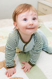 Curiously looking up toddler Stock Photo
