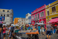CURITIBA ,BRAZIL - MAY 12, 2016: people walking arround and visiting some stands at the market place, nice colorfull. Houses as background royalty free stock photos