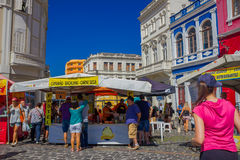 CURITIBA ,BRAZIL - MAY 12, 2016: some people buying food in on of the food stands located at the market place.  stock photography
