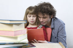 Curl father and daughter read book Stock Photos