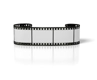 Curl old film strip. Curly film strip on the white background Royalty Free Stock Photo