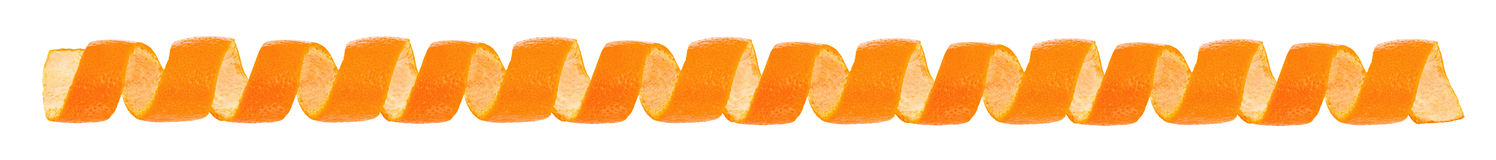 Curl orange peel as a border. Isolated on white background Royalty Free Stock Photos