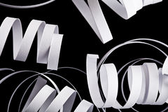 Curl ribbon isolated on black abstract background Royalty Free Stock Images