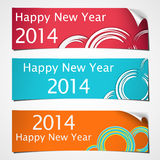 Curled banner 2014. Three banners with curled corner and brush circles colored for celebrating of the happy new year 2014 Royalty Free Illustration