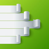 Curled blank paper stripe banners arrow on green Stock Image