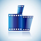 Curled blue cinema tape film human hand with thumb Stock Images