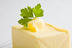 Curled Butter with parsley Stock Photos
